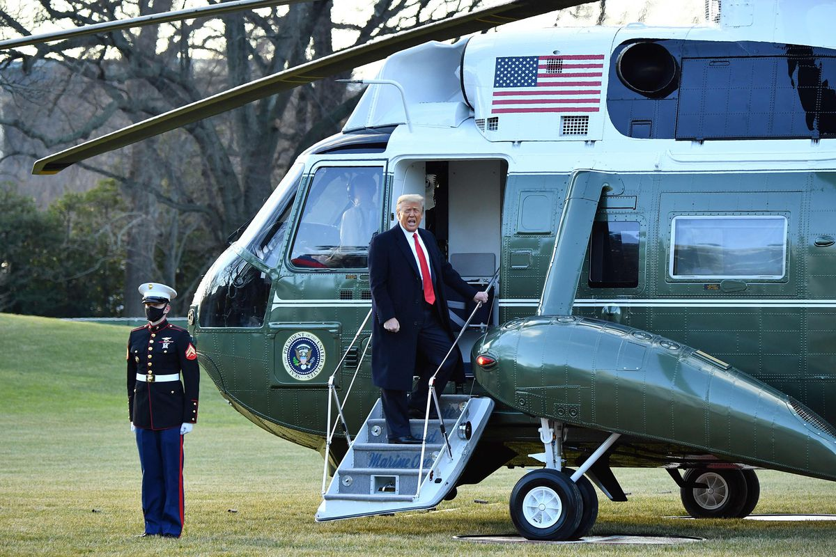 Donald Trump boards Marine One as he departs the White House.