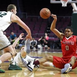 Seattle's Brendan Westendorf (0) loses the ball as he falls back on the court against Utah Valley during the first half of an NCAA college basketball game in the first round of the Western Athletic Conference tournament Thursday, March 9, 2017, in Las Vegas. (AP Photo/David Becker)