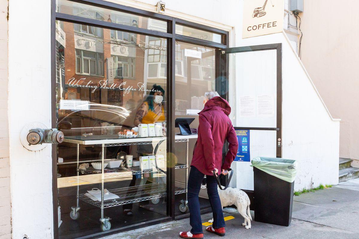Wrecking Ball Coffee has a plexiglass screen set up in its doorway