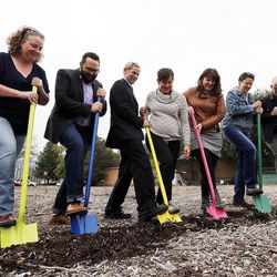 Dignitaries participate in a groundbreaking for the new Central Ninth Market in Salt Lake City, Wednesday, Oct. 28, 2015. The 9,216-square-foot commercial building will be occupied by six locally-owned small businesses, including Jade Market, which will stand as the first local food market in the neighborhood.