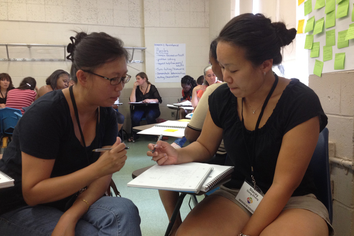 Janet Lo (left) and Stacey Gong-Zhang attend a training program for pre-K teachers.