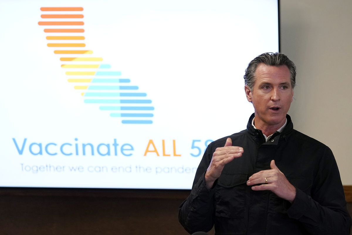 In this March 10, 2021 file photo, California Gov. Gavin Newsom addresses the media during a visit to a vaccination center in South Gate, Calif.