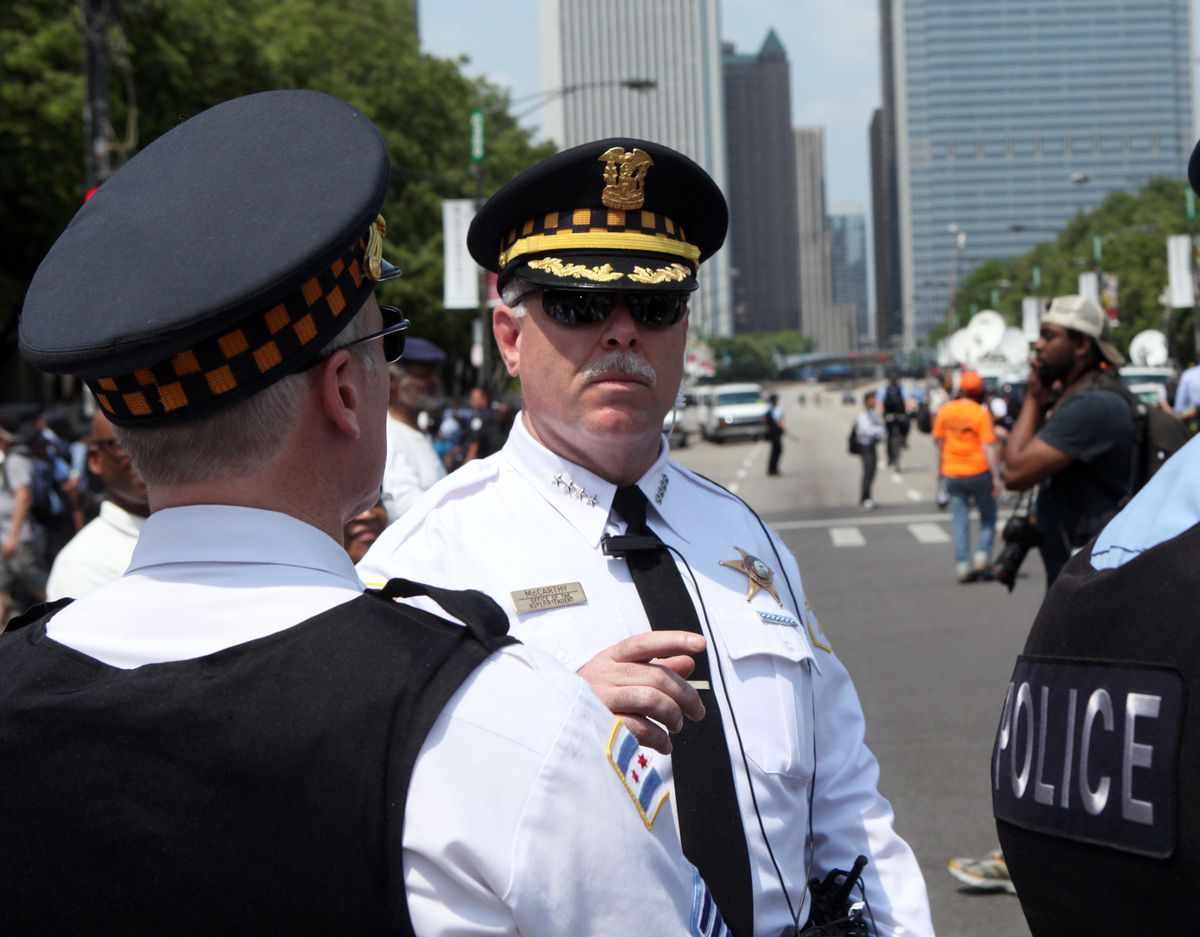 Former Chicago Police Supt. Garry McCarthy talks with officers before a protest march during the NATO summit in Chicago on May 20, 2012