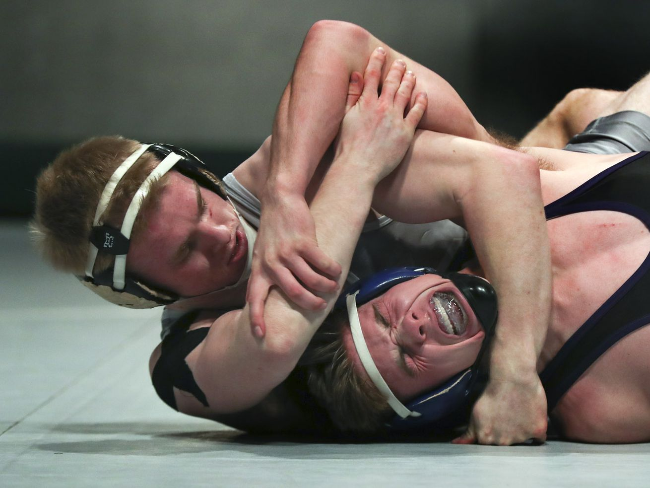 Pleasant Grove's Jake Richardson, left, pulls on North Summit's Tyler Scheurn during the Utah All-Star Dual wrestling matches at UVU's UCCU Center in Orem on Tuesday, Jan. 14, 2020.