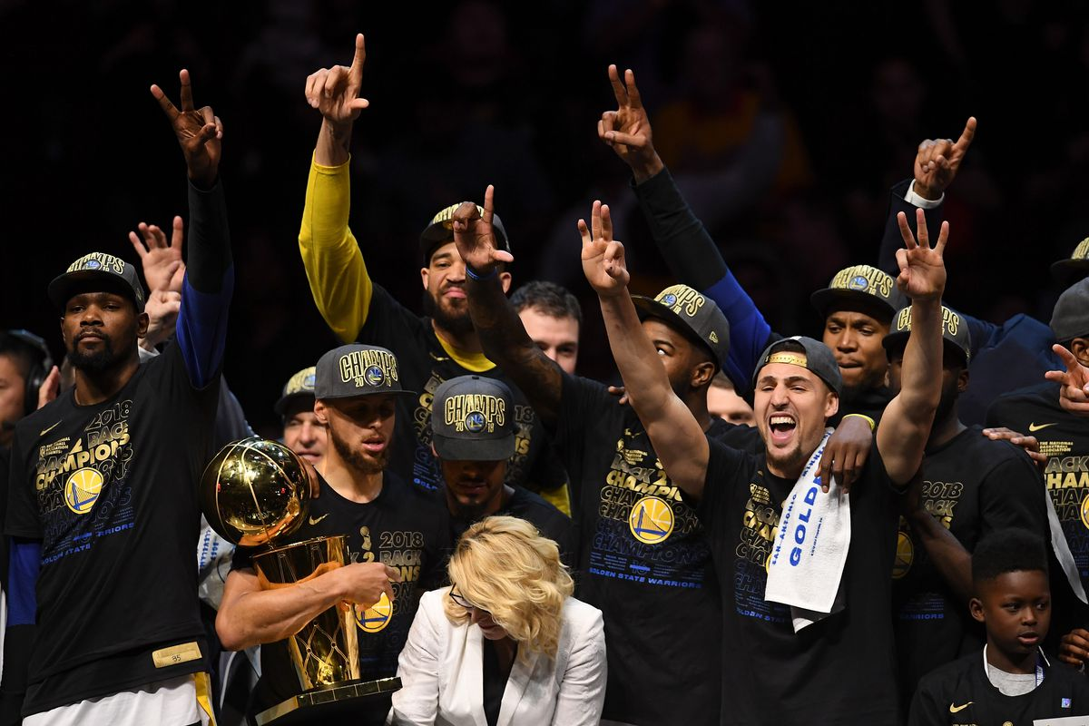 7e1357c5ae7d6 The Golden State Warriors celebrate with the Larry O Brien Trophy after  defeating the Cleveland Cavaliers in Game Four of the 2018 NBA Finals at  Quicken ...