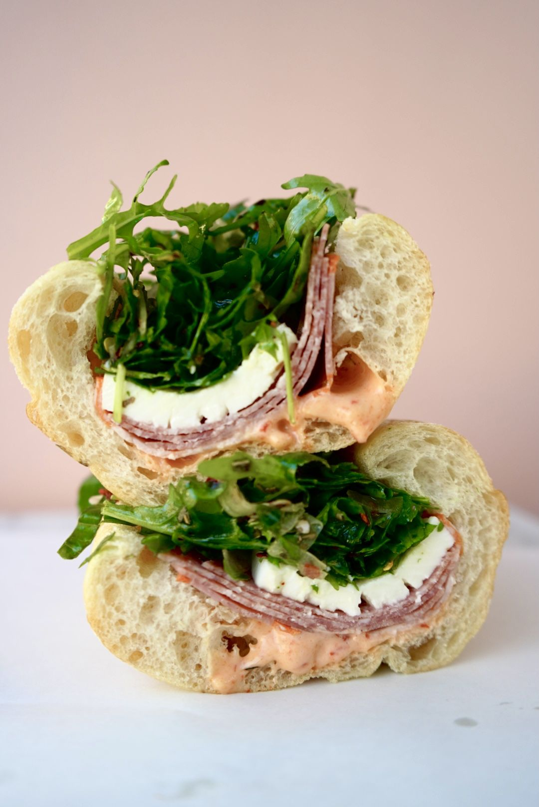 Marisa Tomei Eats Free has capicola, Genoa, salami, fresh mozzarella, basil and arugula salad, and honey chili aioli