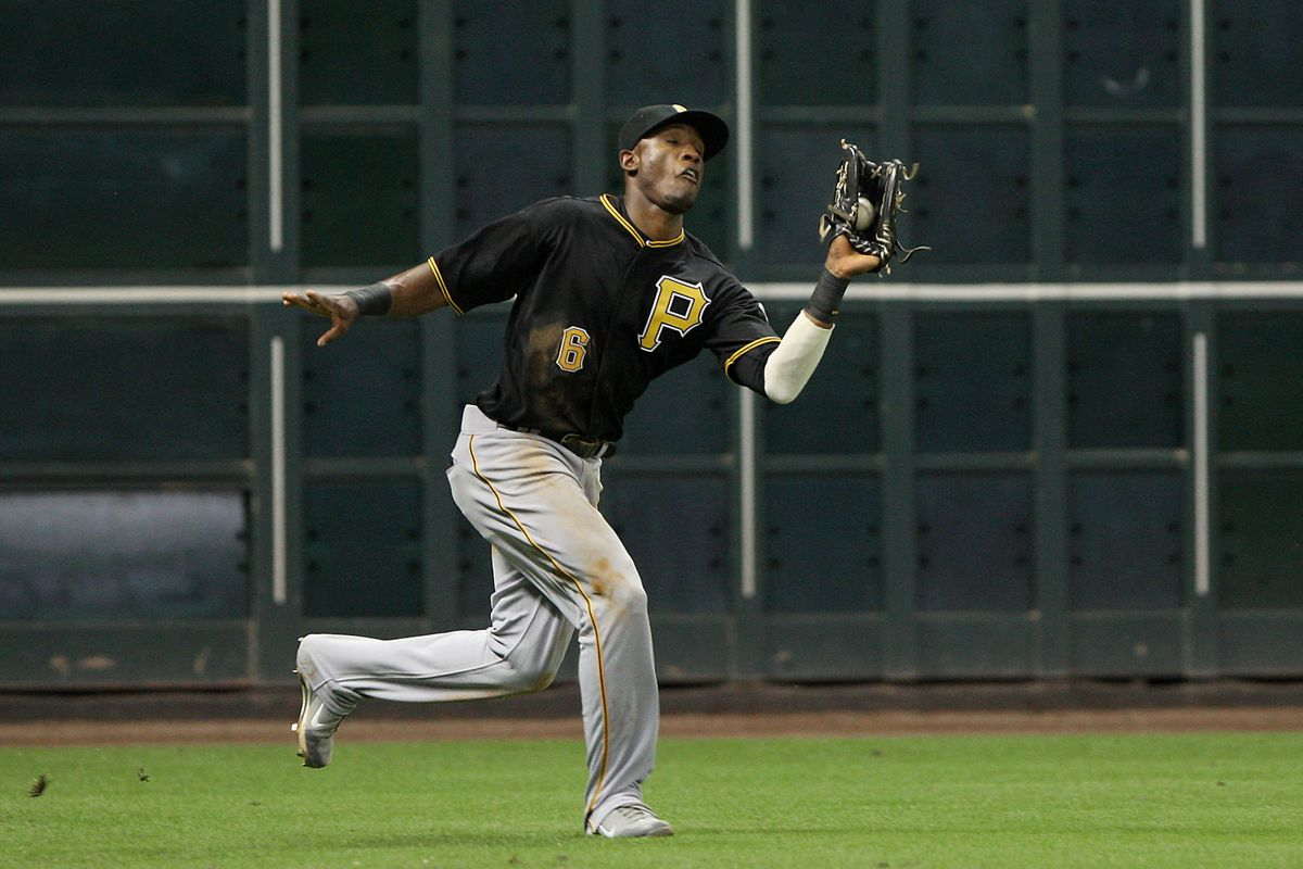 July 26, 2012; Houston, TX, USA; Pittsburgh Pirates outfielder Starling Marte (6) catches a fly ball in the fifth inning against the Houston Astros at Minute Maid Park. Mandatory Credit: Troy Taormina-US PRESSWIRE