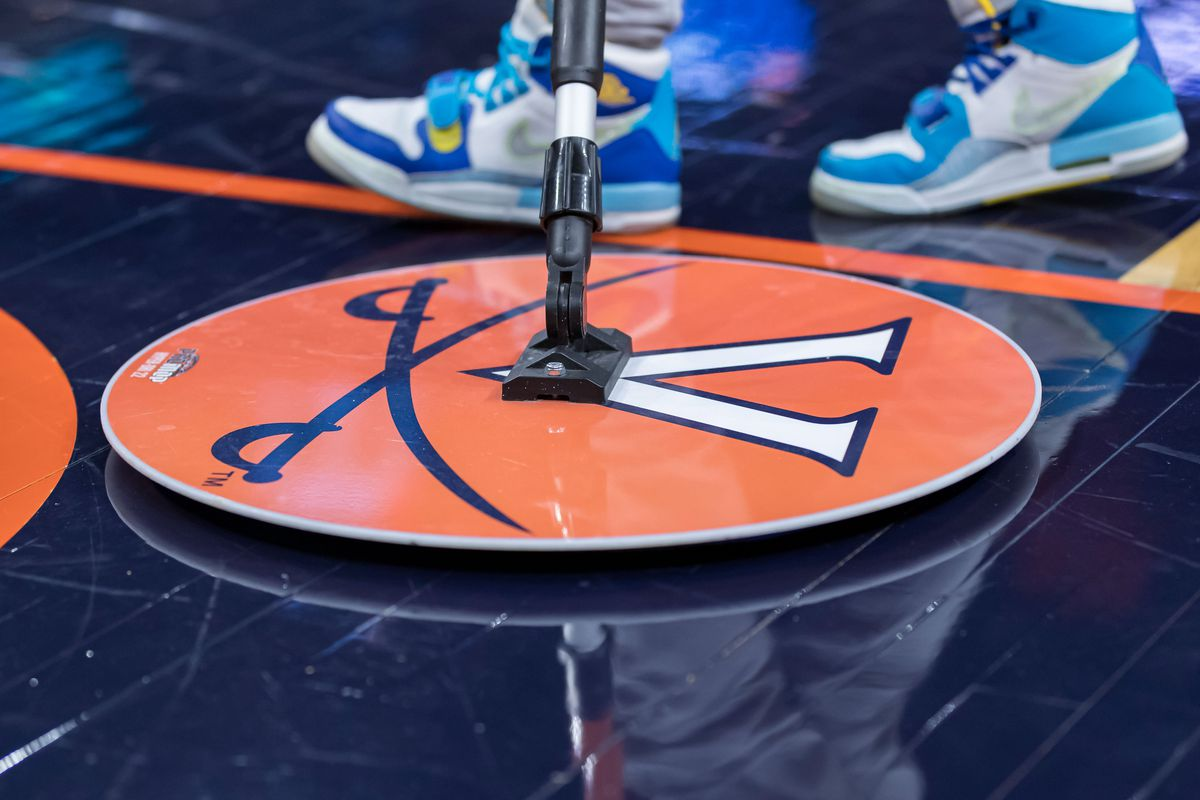 A detailed view of the Virginia Cavaliers logo on a mop used to clean the court during the first half of the game between the Virginia Cavaliers and the Clemson Tigers at John Paul Jones Arena.