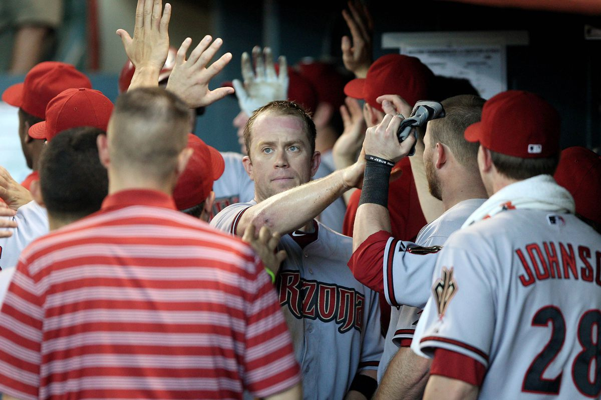 August 19, 2012; Houston, TX, USA; Arizona Diamondbacks infielder Aaron Hill (2) is congratulated after scoring a run in the seventh inning against the Houston Astros at Minute Maid Park. Mandatory Credit: Troy Taormina-US PRESSWIRE