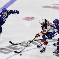 Syracuse Crunch players Hubert Labrie (6) and Alexander Volkov (83) team up to check Binghamton Devils Blake Pietila (19) in American Hockey League (AHL) action at the Floyd L. Maines Veterans Memorial Arena in Binghamton, New York on Friday, October 19, 2018. Syracuse won 4-0.