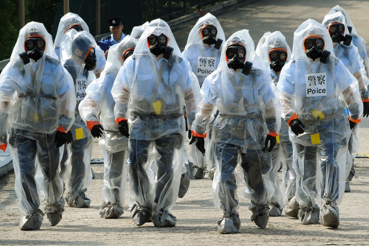 Police, fire and medical services take part in a chemical, biological, radiological and nuclear exercise in Hong Kong on October 27, 2009