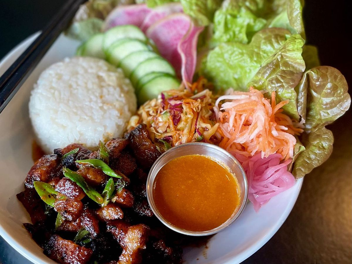 pork belly with lettuce and rice in a bowl