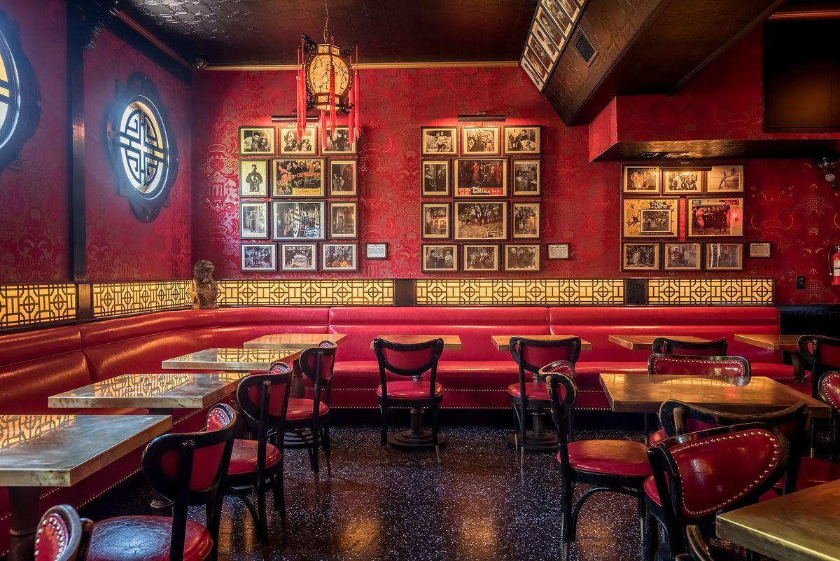 Bright red tones and old photos hang at Formosa