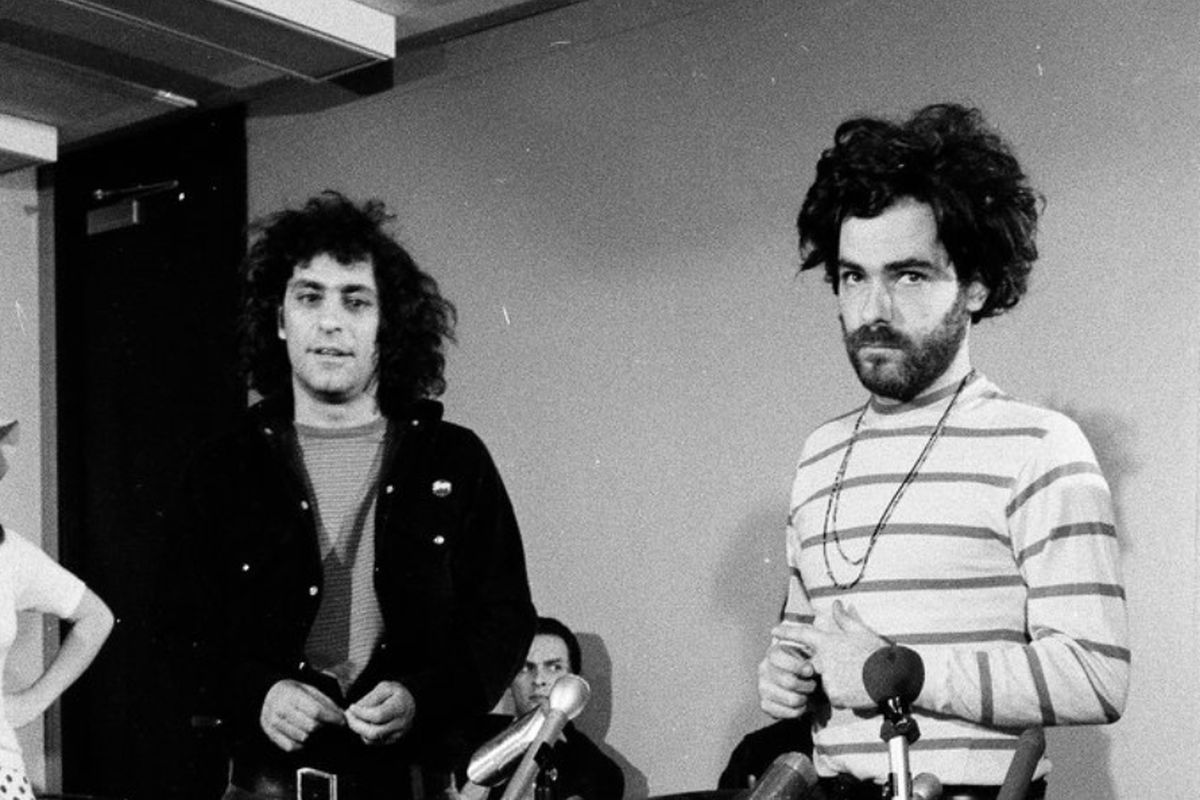 Chicago Seven activist Jerry Rubin puts on a wig during a press conference for the conspiracy trail in Chicago, Oct. 17, 1969.