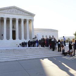 """People stand in line to go into the Supreme Court in Washington, Monday, Oct. 2, 2017, for the first day of the new term. Last week, the Supreme Court heard oral arguments for a case that could fundamentally reshape U.S. privacy laws — and current interpretations of a constitutional amendment. Carpenter v. United States contests a key interpretation of the Fourth Amendment called the """"third-party doctrine."""" This legal theory holds that people have """"no reasonable expectation of privacy"""" when they voluntarily provide personal information to a third party such as a phone company, internet provider or bank."""