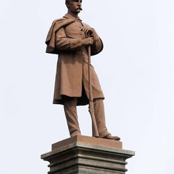 """In this Monday, April 6, 2015 photo, a Civil War statue is on display at Congress Park in Saratoga Springs, N.Y. In the decades after the Civil War ended in April 1865, statues depicting Union and Confederate soldiers were placed in countless American communities, from New England commons to the grounds outside Southern courthouses. A century and a half later, these weathered """"Silent Sentinels"""" still stand guard, most of them at """"parade rest"""" with their muskets at the ready, gazing off in the distance."""