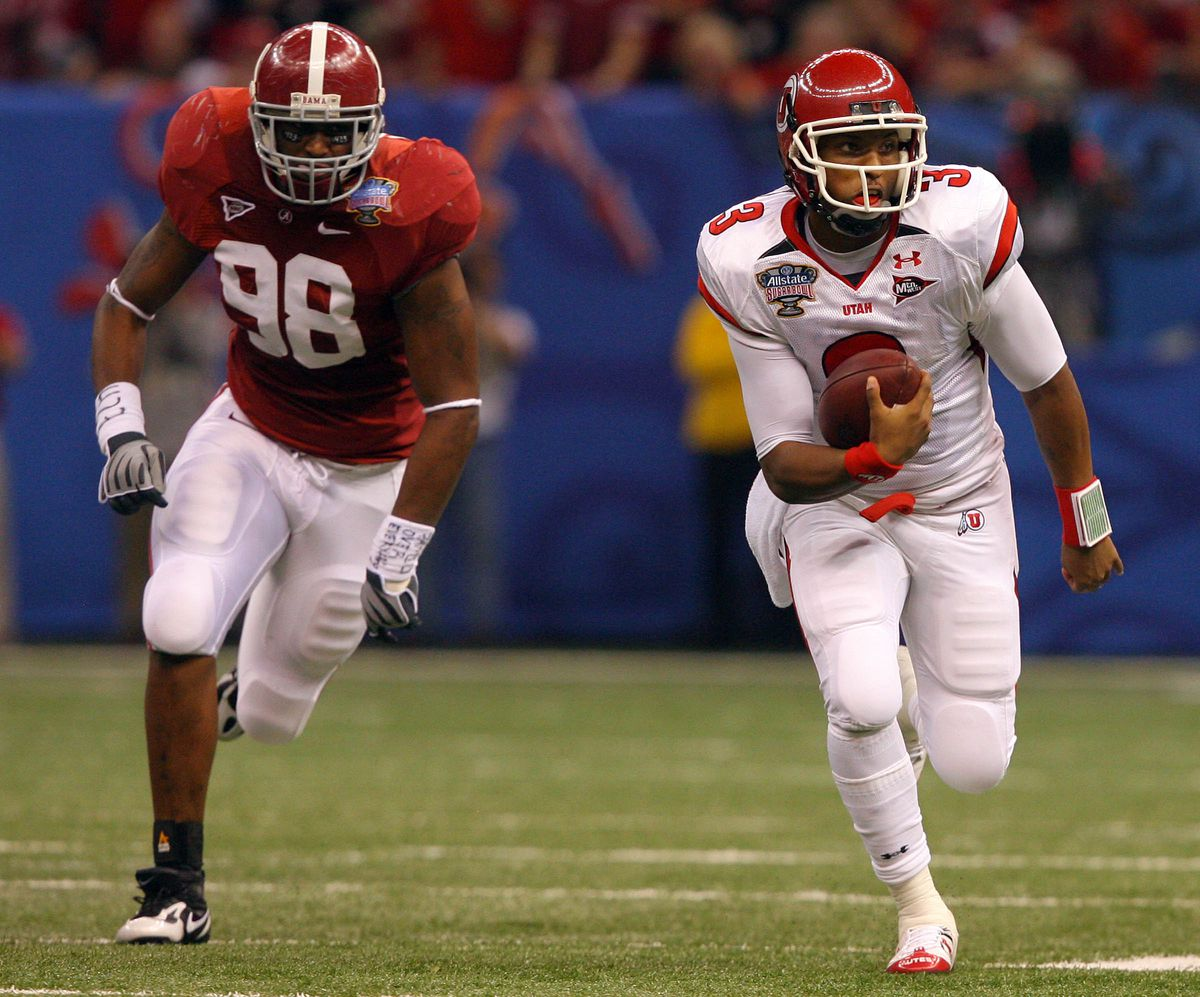 Utah quarterback Brian Johnson, right, runs for a first down against Alabama in the 2009 Allstate Sugar Bowl, at the Superdome, in New Orleans, LA. Friday Jan. 2, 2009.