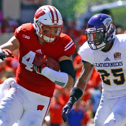 Tight End Sam Arneson reels in a pass and braces for a hit from Western Illinois DB Dallas Nichols