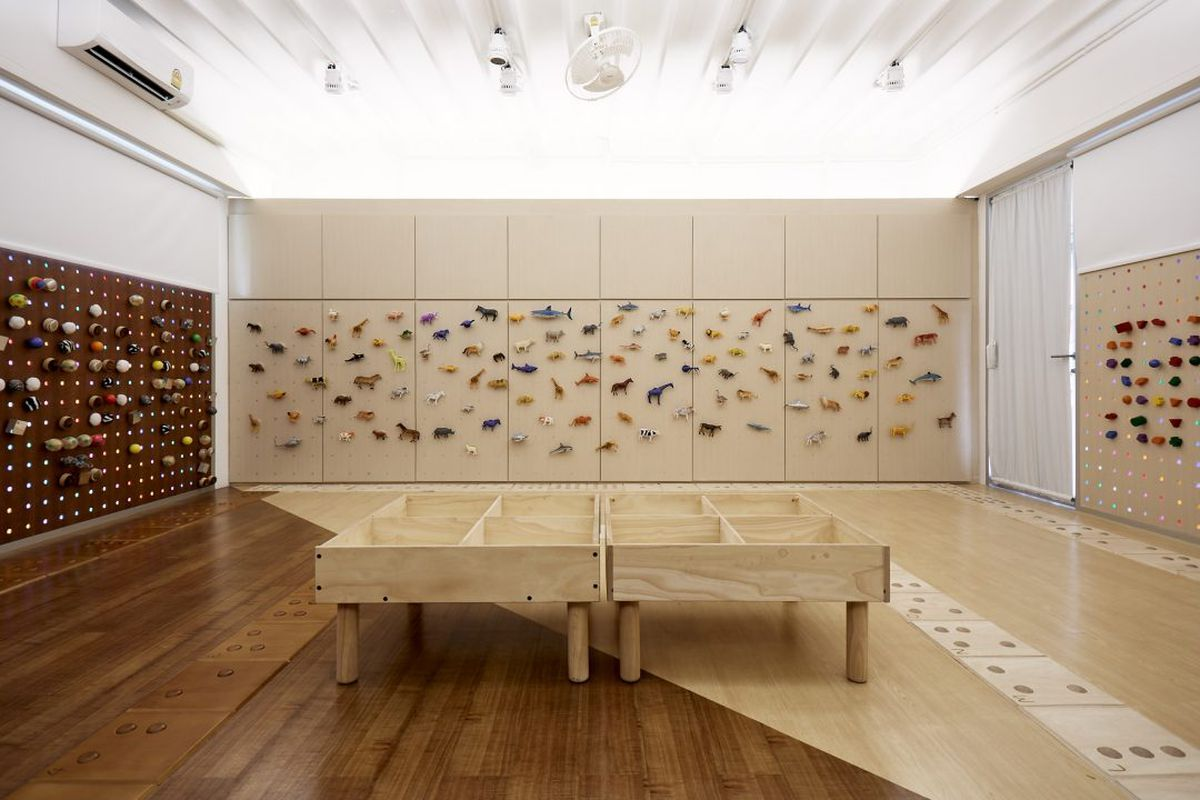 Room with walls covered in animal pegs
