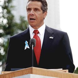 In this Sept. 11, 2011 file photo, New York Gov. Andrew Cuomo delivers his remarks during the 10th anniversary ceremonies at the Sept. 11 memorial, in New York. For the first time, elected officials won?t be allowed to speak Tuesday, Sept. 11, 2012, at  an occasion that has allowed them a solemn turn in the spotlight, a change made in the name of avoiding politics, but rapped by some as a political move in itself.