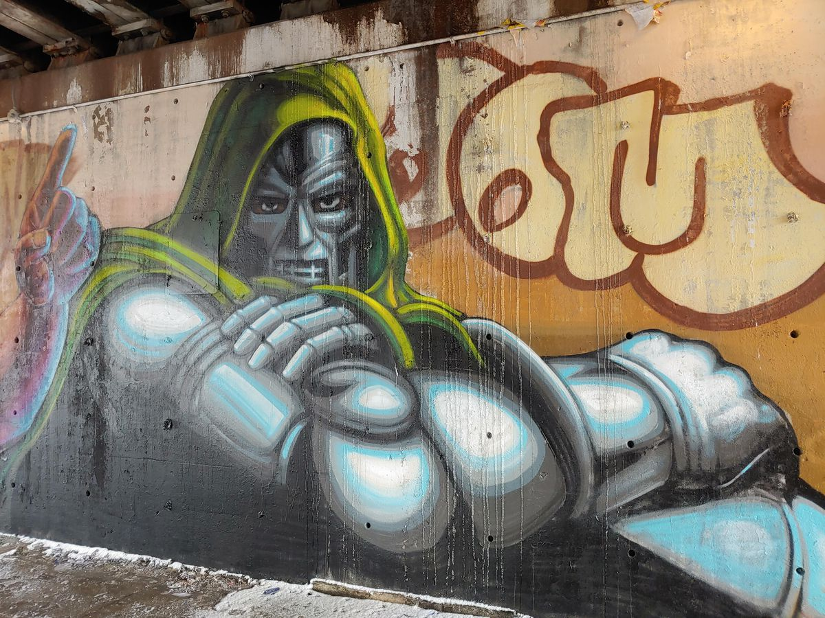 A closeup of Rahmaan Statik's mural near Hubbard and Green streets in the West Loop. This figure is Doctor Doom, a character from Marvel comic books and inspiration for artist MF DOOM's persona.