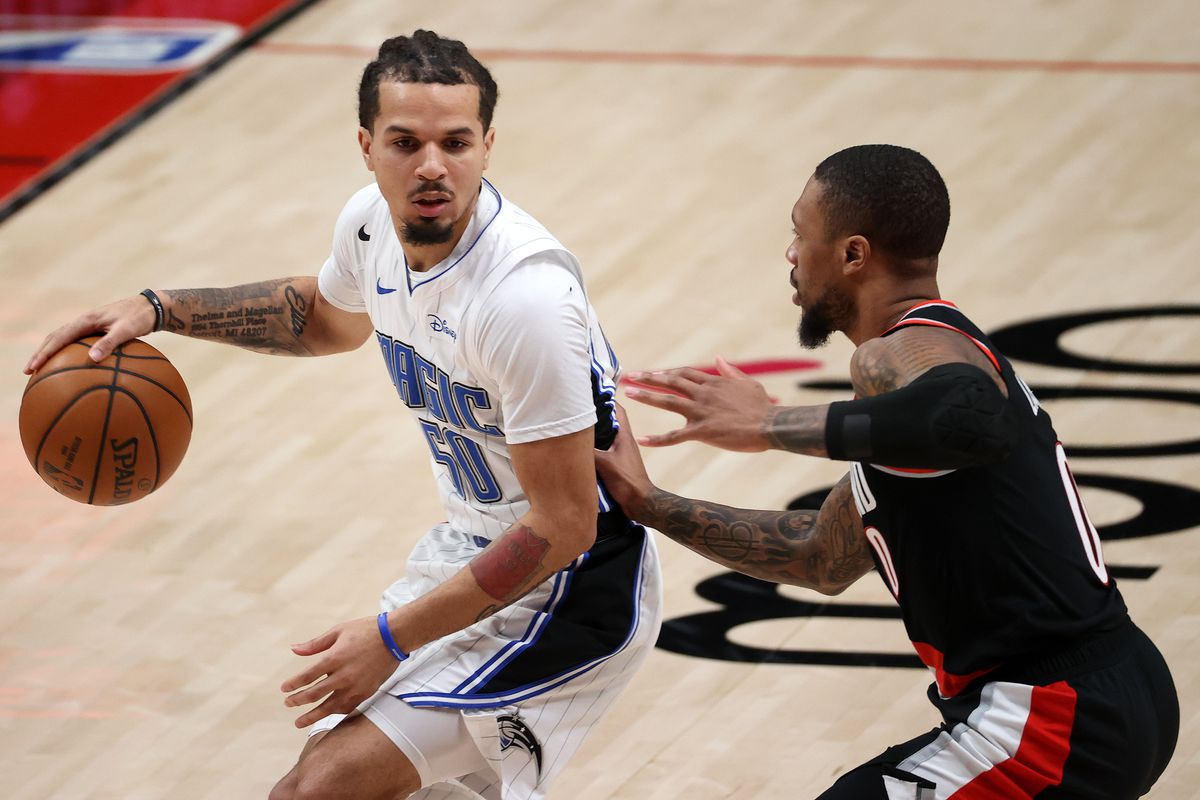 Cole Anthony of the Orlando Magic dribbles against Damian Lillard of the Portland Trail Blazers in the first quarter at Moda Center on February 09, 2021 in Portland, Oregon.