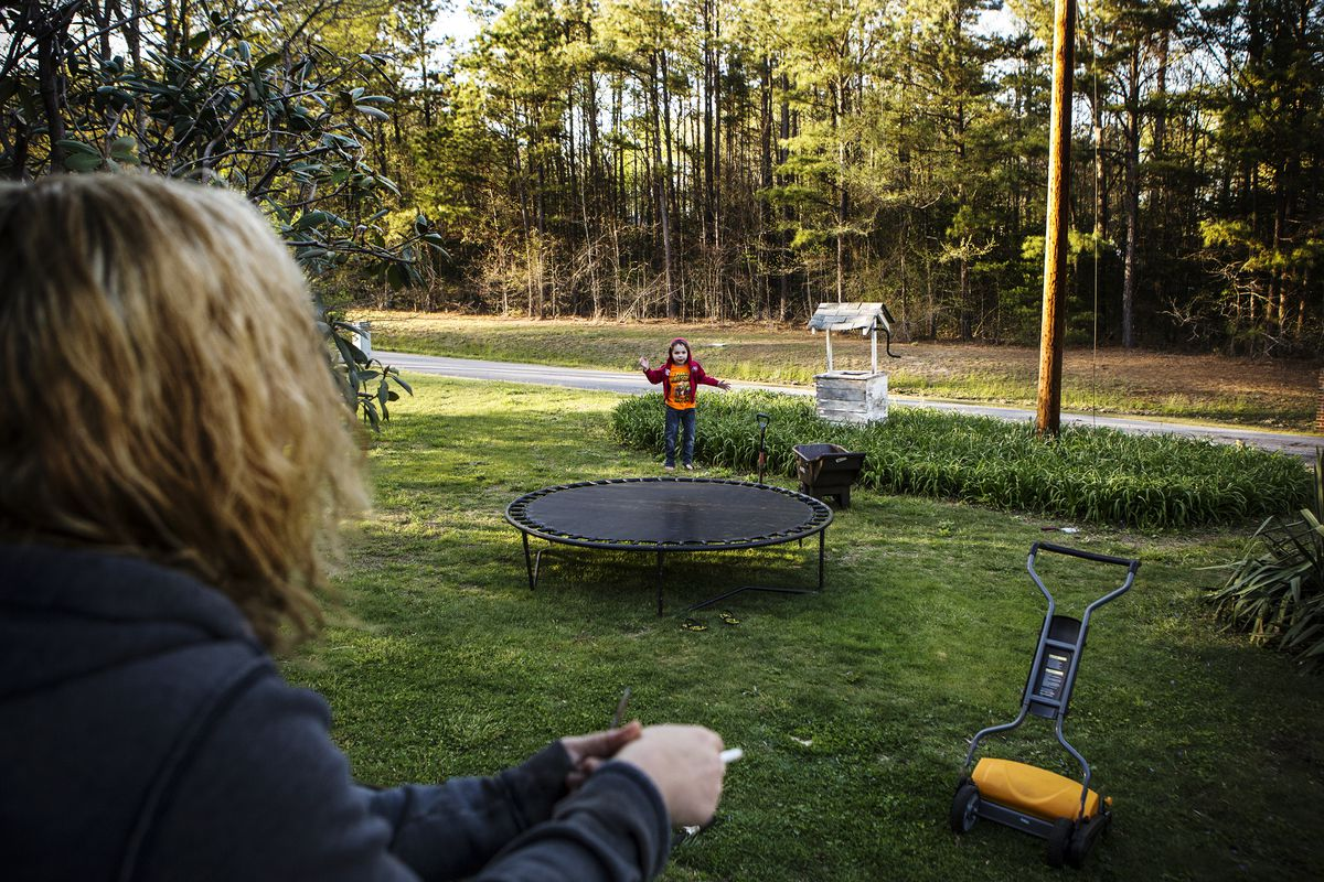 Fawn Ricciuti watches her son Aiden play in her yard outside of Richmond, Virginia.