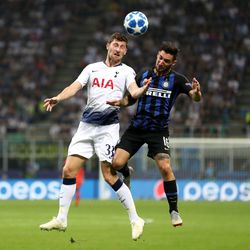 Ben Davies of Tottenham Hotspur battles for possession with Matteo Politano of Inter Milan during the Group B match of the UEFA Champions League between FC Internazionale and Tottenham Hotspur at San Siro Stadium on September 18, 2018 in Milan, Italy.