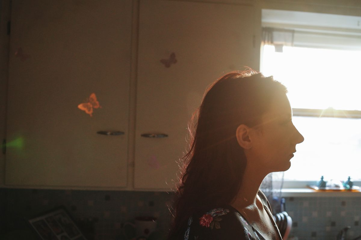 Brianna Jaynes stands in her kitchen in her home near Buffalo, New York.
