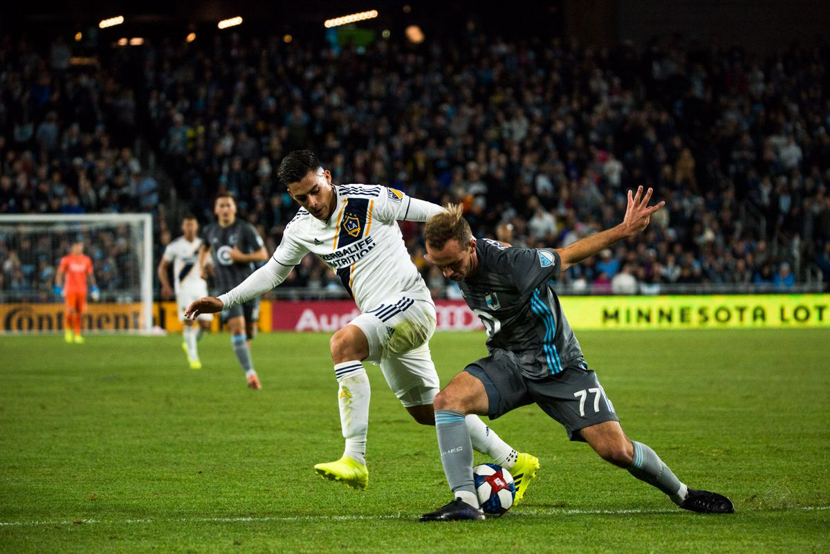 October 20, 2019 - Saint Paul, Minnesota, United States- Chase Gasper fights for a ball during an Audi MLS Cup Playoff match between Minnesota United and The Los Angeles Galaxy at Allianz Field (Photo: Tim C McLaughlin)