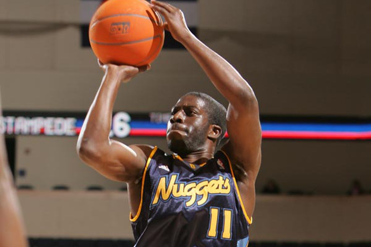 This is when Pooh's D-League team, the Colorado 14ers, had their 'affiliate night' and he wore a Nuggets jersey - he never actually played for the Nuggets.  You could probably tell that by the ball, but just in case.