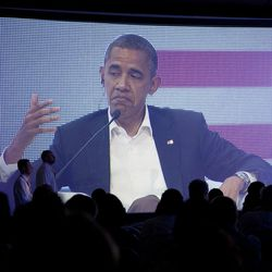 President Barack Obama is pictured on a large video screen during a three-way conversation with Brazil's President Dilma Rousseff and Colombia's President Juan Manuel Santos, not pictured, at the CEO Summit of the Americas, in Cartagena, Colombia, Saturday April 14, 2012. Regional business leaders are meeting parallel to the sixth Summit of the Americas which brings together presidents and prime ministers from Canada, the Caribbean, Latin America and the U.S. (AP Photo/Carolyn Kaster)