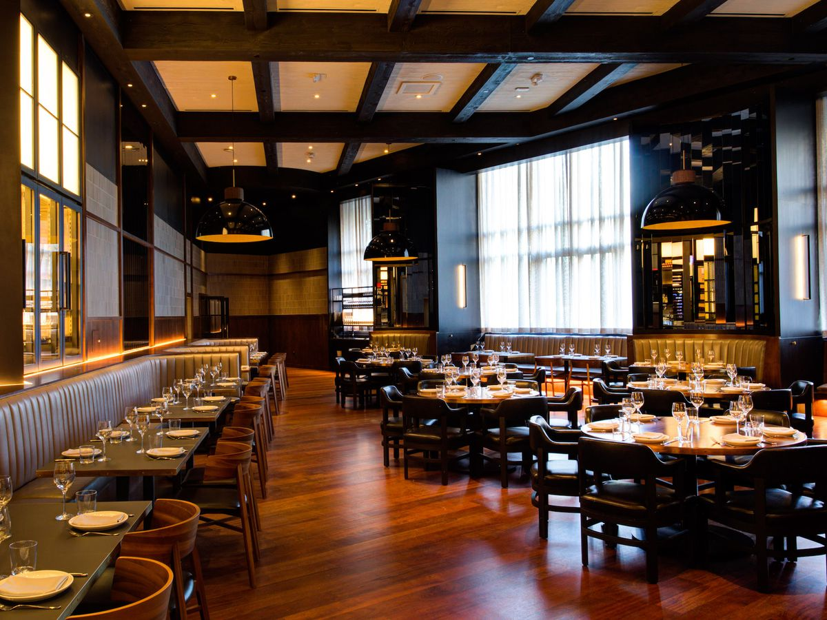 A wide shot of the dining room at Majordomo Meat & Fish