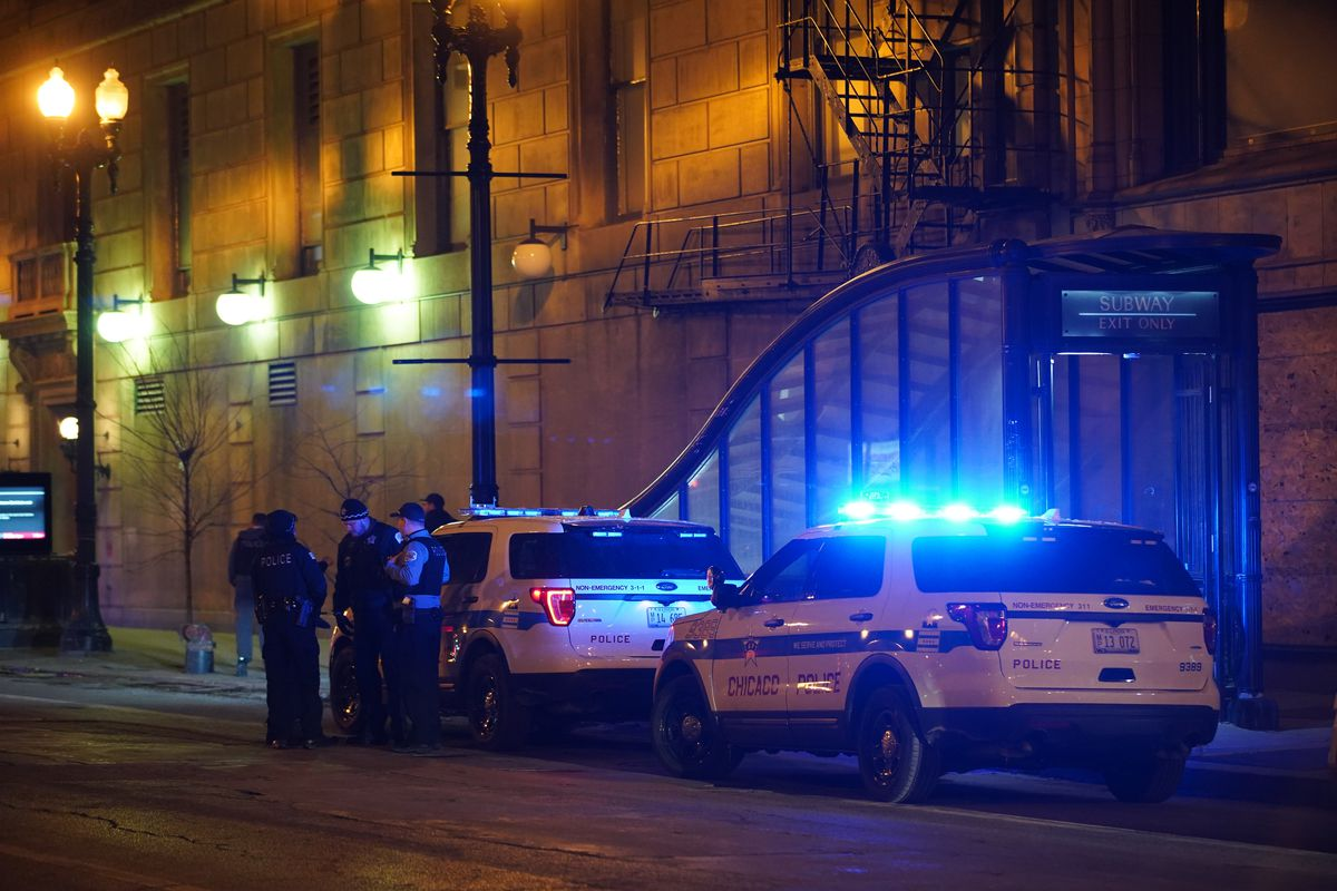 Chicago police at the scene of a stabbing Feb. 26, 2020, on a Blue Line train in the 300 block of South Dearborn Street.