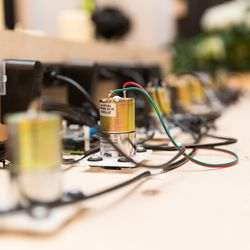 These servo motors will be hidden inside a table, causing the magnet-attached table settings to rattle and shake as guests approach