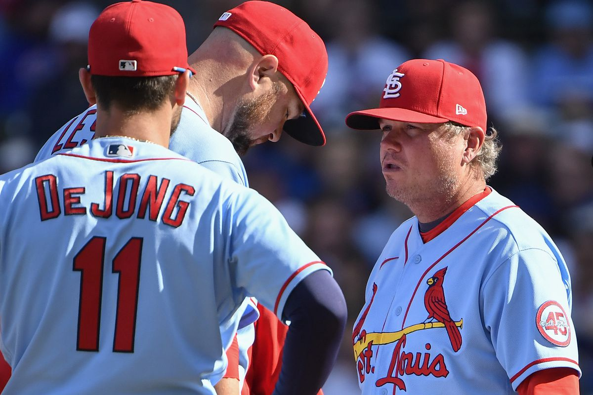 Manager Mike Shildt #8 of the St. Louis Cardinals discusses with Jon Lester #31 of the St. Louis Cardinals during the game against the Chicago Cubs at Wrigley Field on September 25, 2021 in Chicago, Illinois.