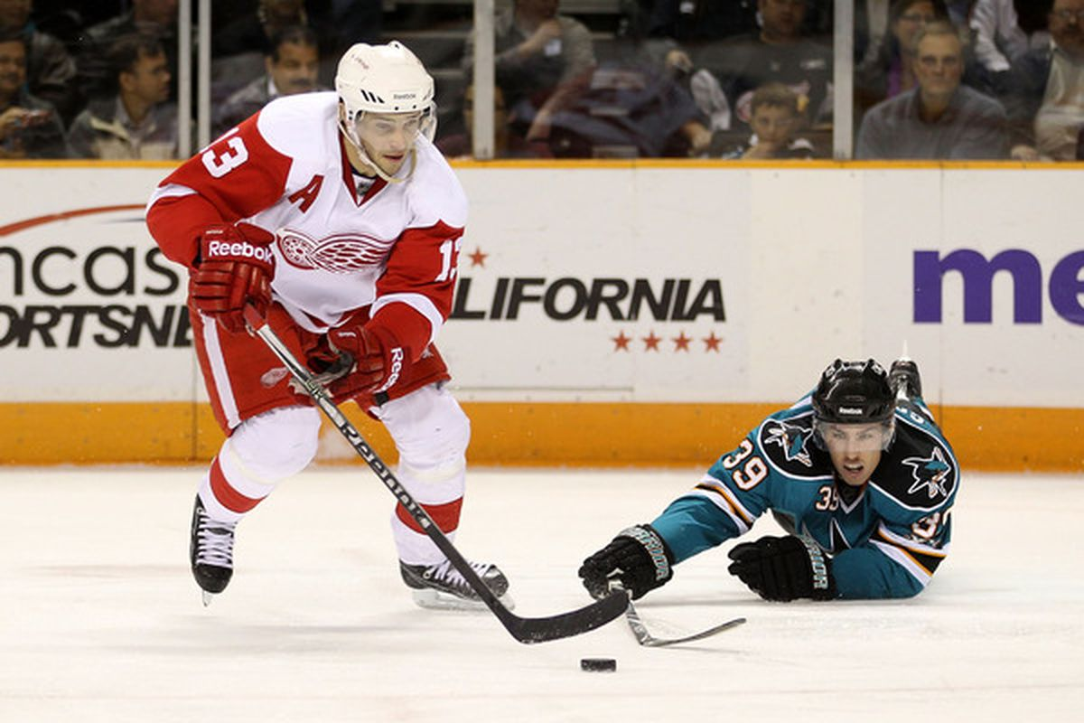 SAN JOSE CA - NOVEMBER 30:  Pavel Datsyuk #13 of the Detroit Red Wings and Logan Couture #39 of the San Jose Sharks go for the puck at HP Pavilion on November 30 2010 in San Jose California.  (Photo by Ezra Shaw/Getty Images)