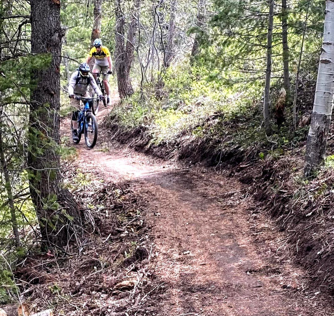 Walt Chudleigh and Les England ride the Slate Creek Mountain Bike Trail.