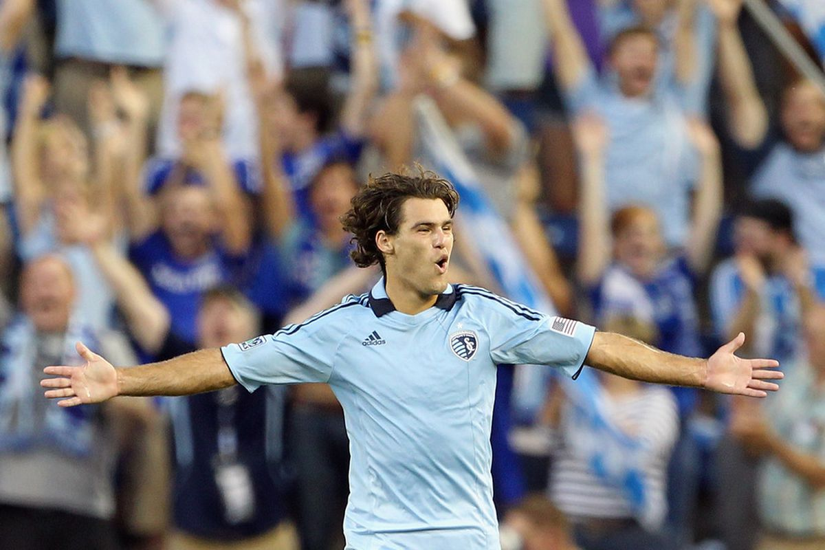 Vision, pace, a cannon right leg... oh, and that head of hair. Yes, it's safe to say life is good for Sporting KC midfielder Graham Zusi.(Photo by Jamie Squire/Getty Images)