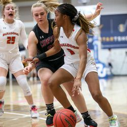 Judge Memorial's Marika Collins (3) drives the ball against Grantsville during the 3A girls basketball semifinals at the Lifetime Activities Center in Taylorsville on Friday, Feb. 21, 2020.