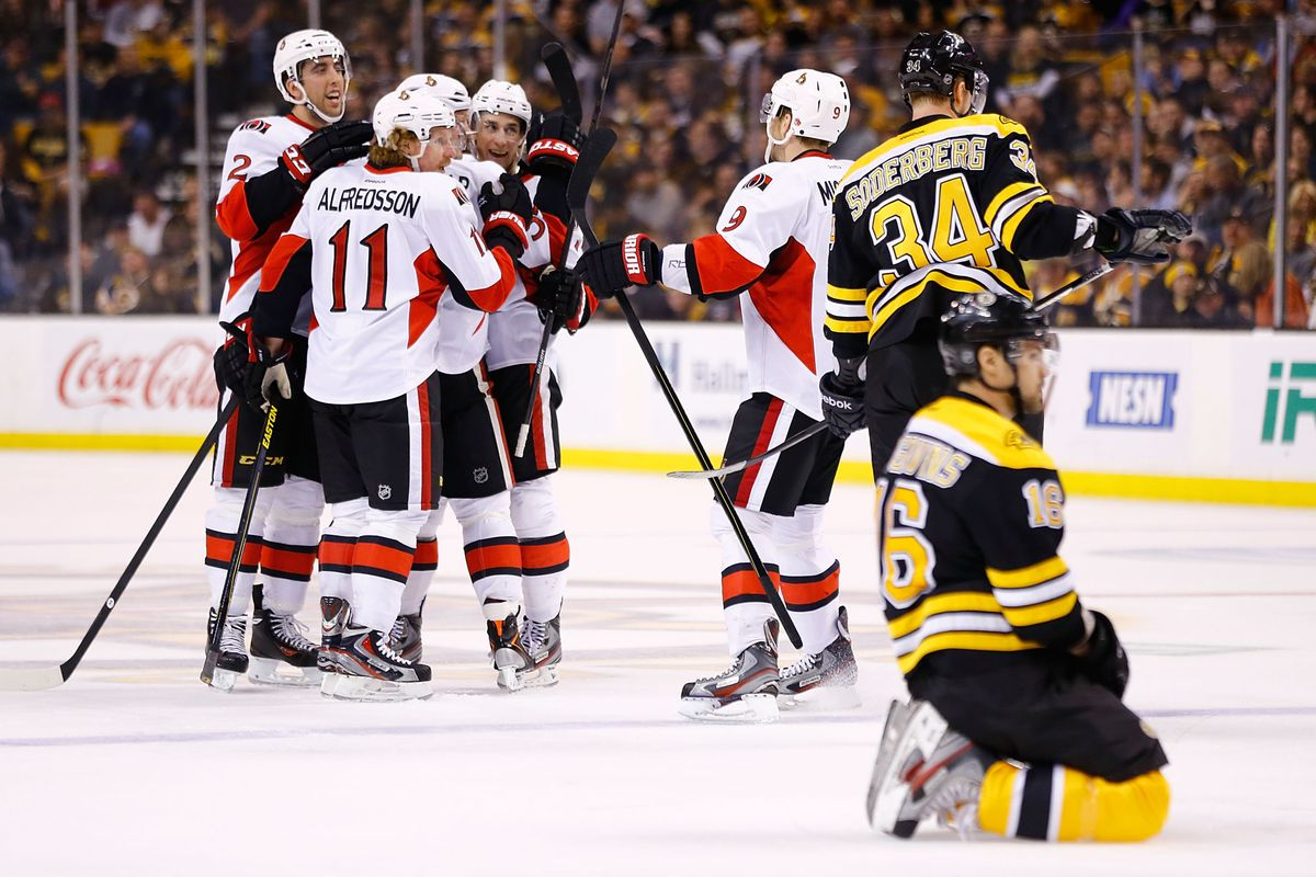 Kaspars Daugavins rests on his haunches in the foreground as the Senators celebrate Jared Cowen's second period goal.