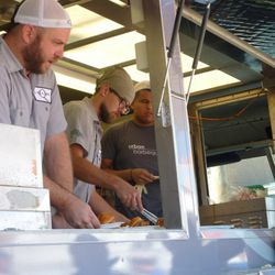 Serving up pulled pork sandwiches off the new Lillie's Q food truck.