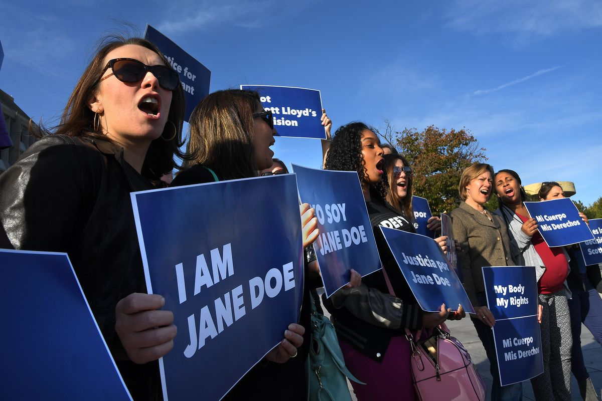 Protesters supporting Jane Doe outside the Department of Health and Human Services on October 20