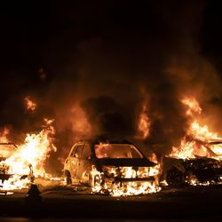 A used car lot is one of several businesses to burn during the second night of unrest after police shot Jacob Blake, Monday night, Aug. 24, 2020.
