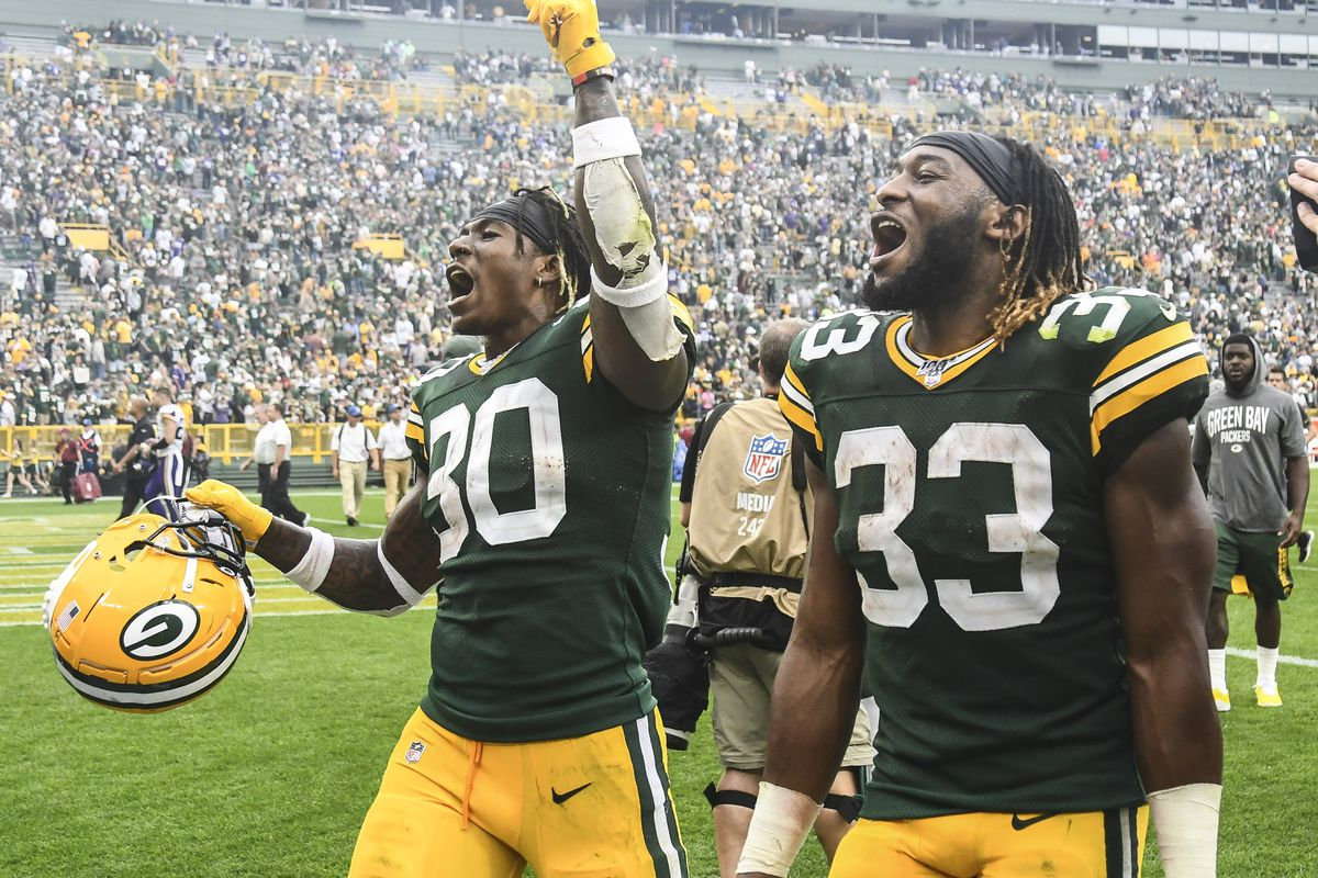 Green Bay Packers running back Jamaal Williams and running back Aaron Jones react after the Packers beat the Minnesota Vikings at Lambeau Field.