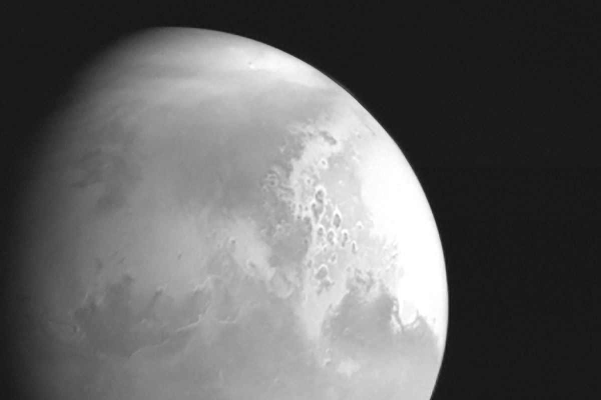 In this undated photo released by the China National Space Administration, a view of the planet Mars is captured by China's Tianwen-1 Mars probe from a distance of 1.37 million miles.