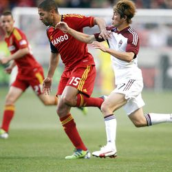 Alvaro Saborio of Real Salt Lake battles for control of the ball against Kosuke Kimura of the Colorado Rapids during their MLS match up at Rio Tinto Stadium in Sandy Saturday, April 7, 2012.