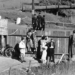 West Germans look over the fence between West and East Germany, near Vacha on Jan. 2, 1958, at three members of the East German Communist People's Police.