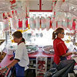 Davis Amusement employees Debbie Davis, left, and Rhonda Edie man a concession stand Saturday at the Utah State Fair in Salt Lake City.