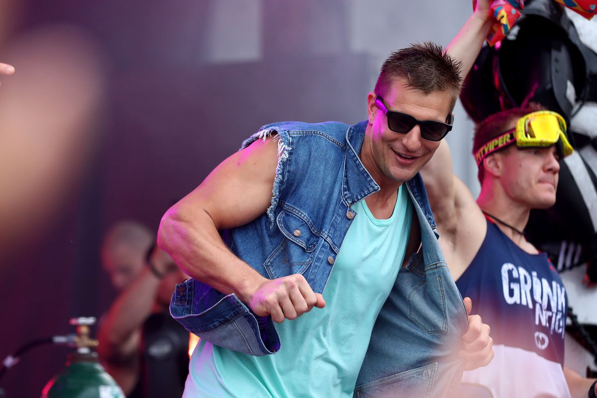 """Rob Gronkowski is seen on stage during """"Gronk Beach"""" at North Beach Bandshell & Beach Bowl on February 01, 2020 in Miami, Florida."""